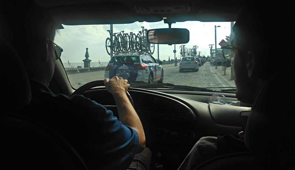 In the Pizzeria Espanola team car at the Vuelta Segovia